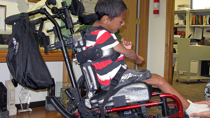Taylor sitting in dynamic wheelchair