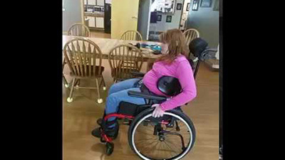 Amanda uses her Dynamic Back to rock and to help propel her wheelchair