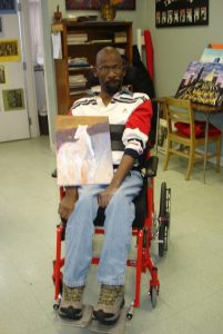 Derrick holding a painting